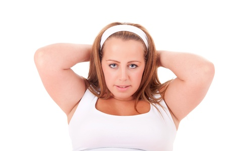 Beautiful large woman exercising - isolated over a white background photo