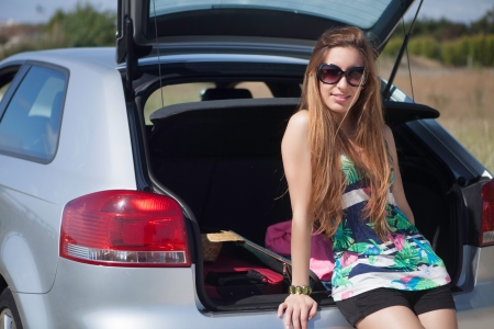 Young happy woman leaving for vacations photo