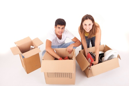 Young couple moving to new house, isolated over white photo