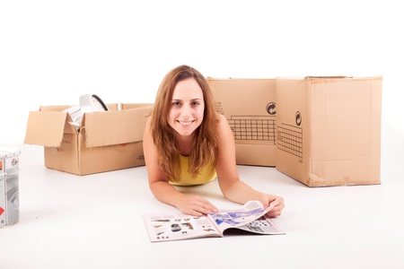 Young woman moving to new house, isolated over white photo