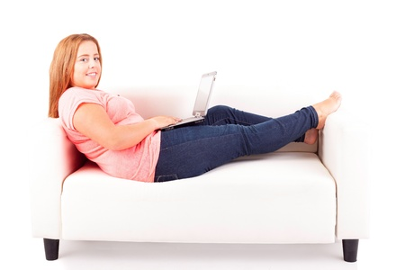 Young overweighted woman relaxing at home photo