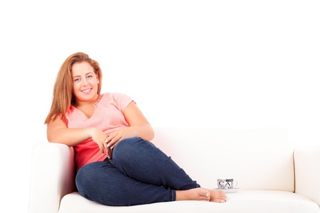 unattractive: Young overweighted woman relaxing at home