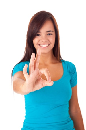Happy young student expressing positivity sign, isolated over white Stock Photo - 15929760