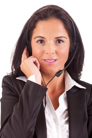 Friendly young beautiful telephone operator at work photo