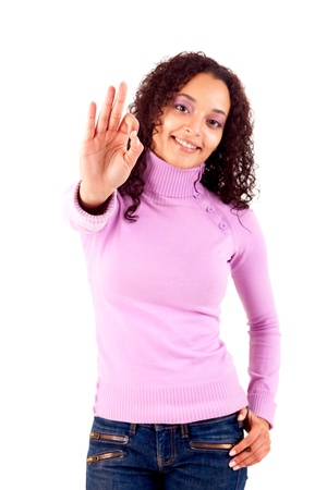 Happy young woman expressing positivity sign, isolated over white Stock Photo - 16472660