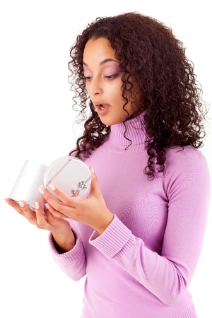 Happy young woman holding a gift, isolated over white Stock Photo - 16472704