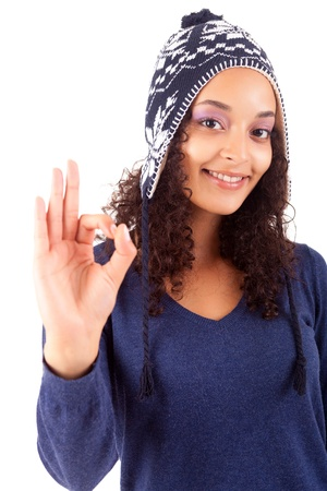 Happy young woman expressing positivity sign, isolated over white photo