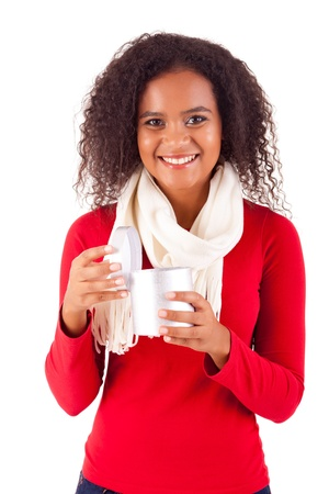 Happy young woman holding a gift, isolated over white Stock Photo - 16547829