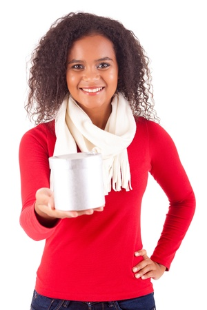 Happy young woman holding a gift, isolated over white Stock Photo - 16547782