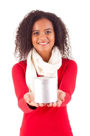 Happy young woman holding a gift, isolated over white Stock Photo - 16547798