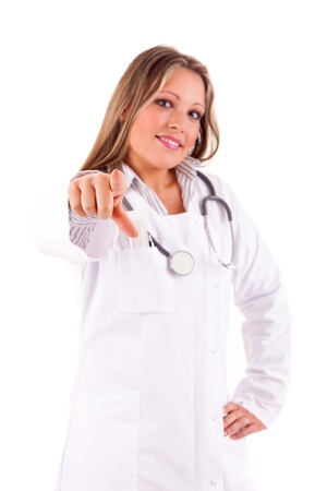 authoritative woman: Young doctor pointing forward - isolated over white Stock Photo