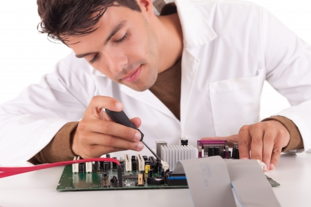 computer hardware: Happy and successful young computer engineer