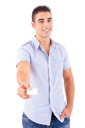 Young casual man offering a greeting card, isolated over white photo
