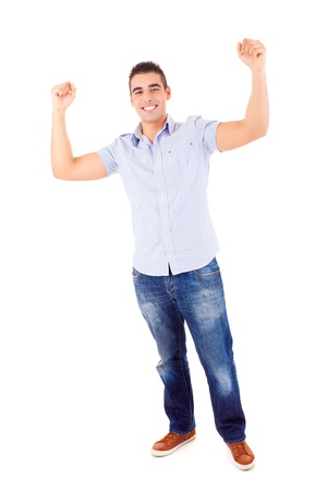 Studio picture of a happy young man with arms raised photo