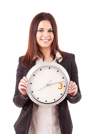 Young business woman holding a white clock, isolated over white background Stock Photo - 17420979