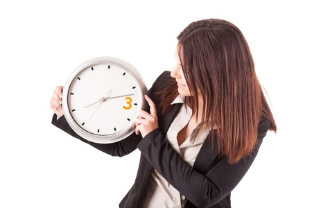 Young business woman holding a white clock, isolated over white background Stock Photo - 17421051