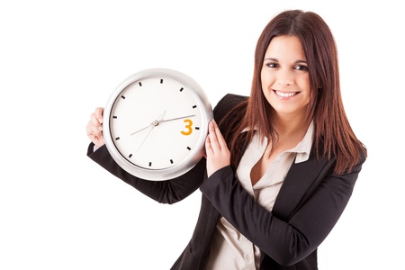Young business woman holding a white clock, isolated over white background Stock Photo - 17421041