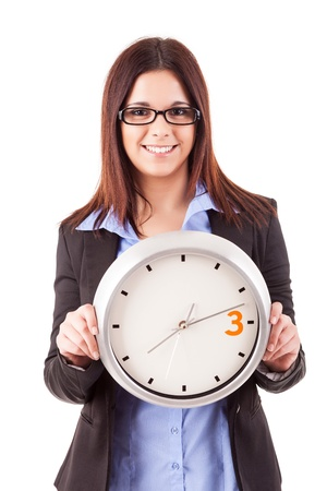 Young business woman holding a white clock, isolated over white background Stock Photo - 17420992