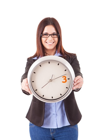 Young business woman holding a white clock, isolated over white background Stock Photo - 17421193