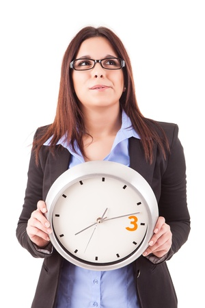Young business woman holding a white clock, isolated over white background Stock Photo - 17421034