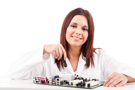 Happy and successful young computer technician photo