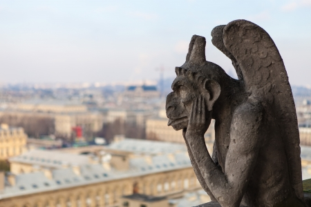 chimera: Notre Dame of Paris: Famous Chimera (demon) overlooking the Eiffel Tower at a summer day