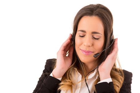 Friendly young beautiful telephone operator at work Stock Photo - 17848523