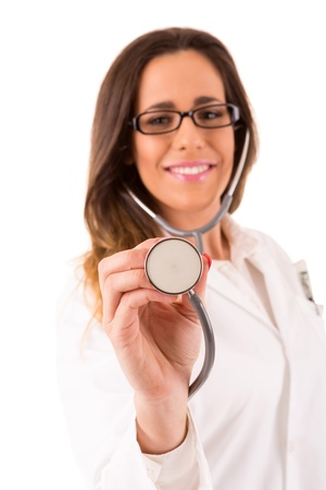 Young nurse holding stethoscope - isolated over white photo