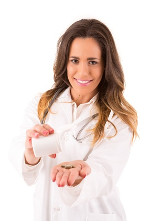 Medic holding some pills, isolated over white photo
