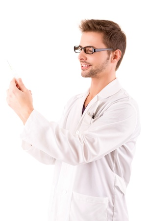 Young and handsome medic holding a syringe photo