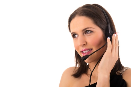 Friendly young beautiful telephone operator at work Stock Photo - 18741015