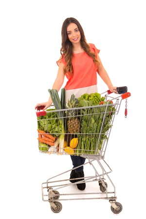 Beautiful young woman shopping at the supermarket photo