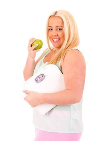 Large woman holding a scale - diet concept