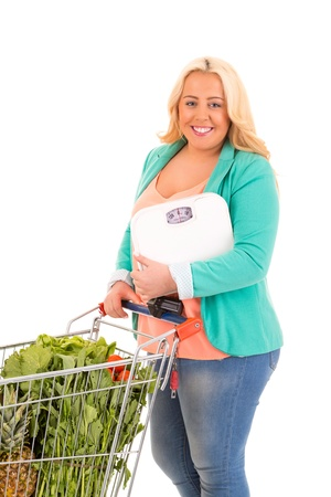 Large woman at the supermarket in search for healthy food - diet concept photo