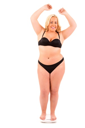 A very large woman on a scale - diet concept Stock Photo
