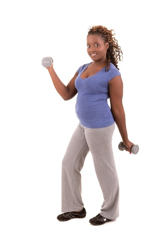 Beautiful large african woman doing exercise - Isolated over white photo