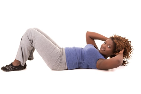 Beautiful large african woman doing exercise - Isolated over white Stock Photo - 19540326
