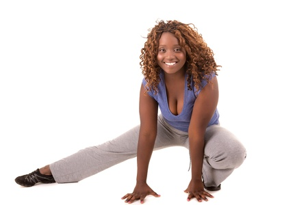 sexy pregnant woman: Beautiful large african woman doing exercise - Isolated over white Stock Photo