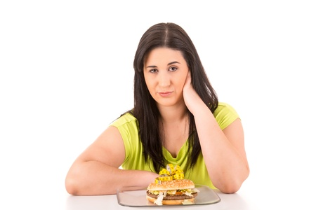 Beautiful large woman, trying to resist to an appetizing hamburger, which would kill her diet photo
