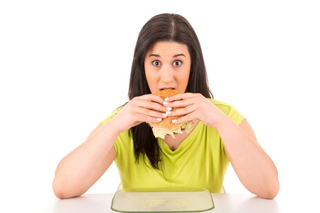 Beautiful large woman, could not resist to an appetizing hamburger, and kills her diet photo