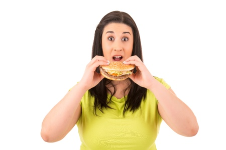 could: Beautiful large woman, could not resist to an appetizing hamburger, and kills her diet Stock Photo