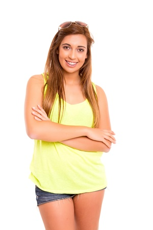 Happy teenager wearing braces, posing isolated over a white background photo