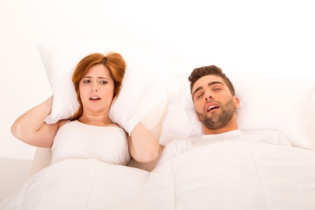 Portrait of an annoyed woman awaken by her fiances snoring  photo