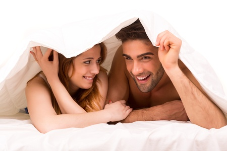 romantic sex: A beautiful young passionate couple in bed