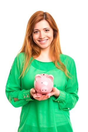 Young woman holding a piggy bank (money box) - savings concept Stock Photo - 19915158