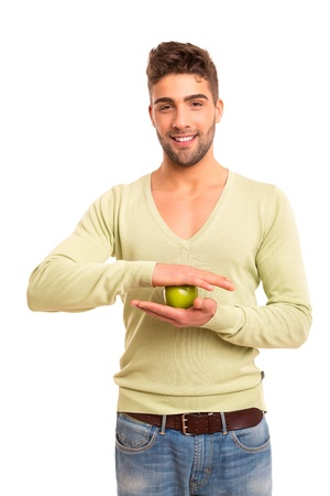 Handsome young man holding a green apple - diet  nutrition concept photo