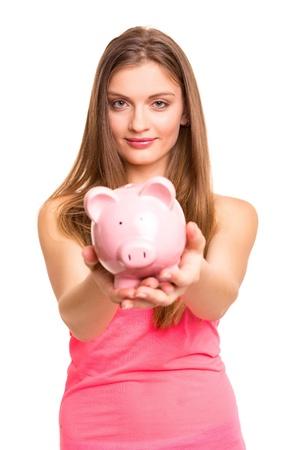 Young woman holding a piggy bank (money box) - savings concept Stock Photo - 20052840