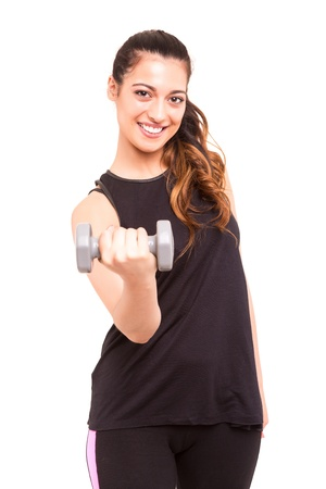 A beautiful young woman in great shape - fitness concept photo