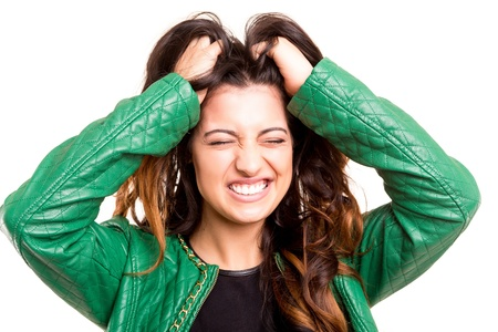 Stressed woman grabbing her hair in frustration photo