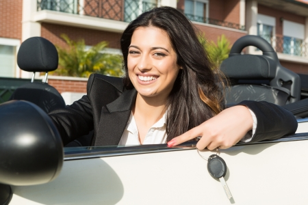 A young successful business woman in a luxurious convertible sports car photo